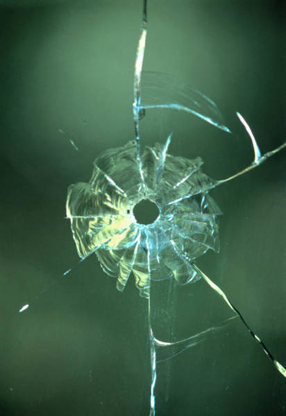 Wall Art - Photograph - Bullet Hole In Glass by Sheila Terry/science Photo Library