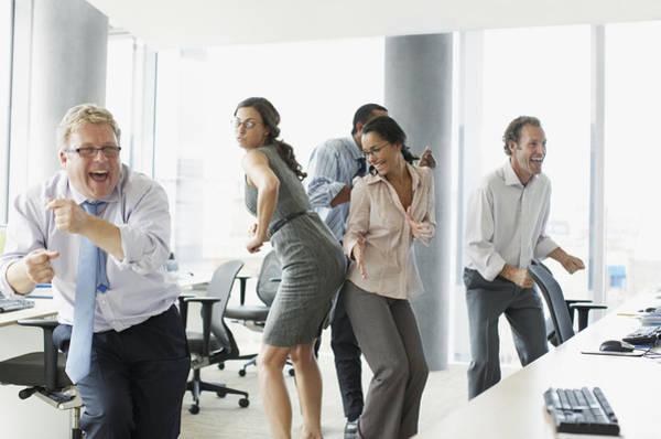 Businesspeople Dancing In Office Art Print by Paul Bradbury