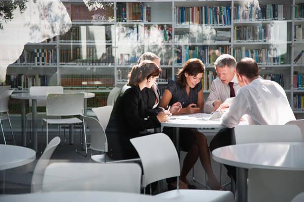 Businesspeople In Office Meeting Art Print by Tom Merton