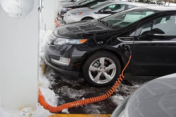 Plug-in Photograph - Chevrolet Volt Electric Car Charging by Jim West