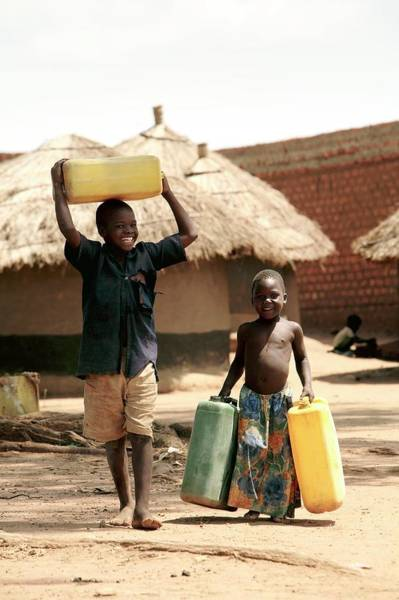 Wall Art - Photograph - Children Carrying Water by Mauro Fermariello/science Photo Library