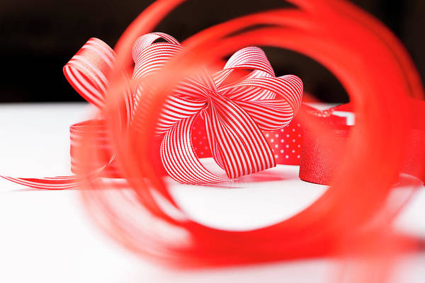 Celebration Photograph - Close Up Of Decorative Red Ribbons by Nils Hendrik Mueller