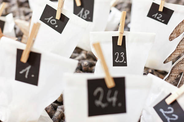 Home Interior Photograph - Close Up Of Numbered Bags by Nils Hendrik Mueller