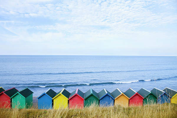 Beach Holiday Photograph - Colourful Beach Huts Along The Seafront by Andrew Bret Wallis