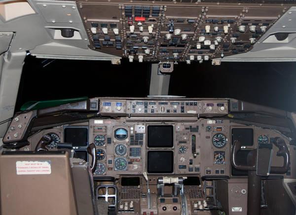 Photograph - Commercial Airplane Cockpit by Gunter Nezhoda