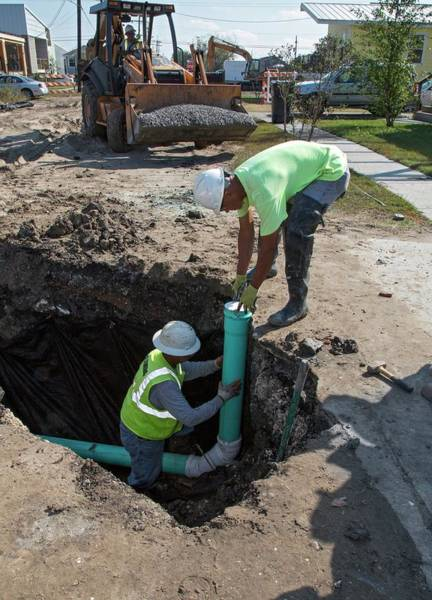Lower Ninth Ward Photograph - Connecting Domestic Sewers by Jim West