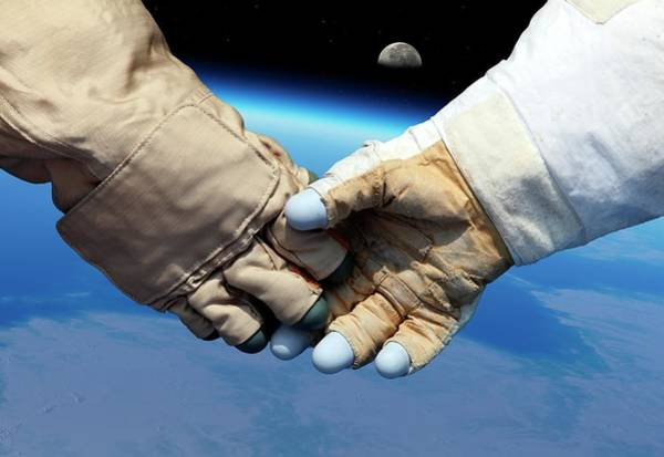 Astronaut Wall Art - Photograph - Cosmonaut And Astronaut Shaking Hands by Detlev Van Ravenswaay