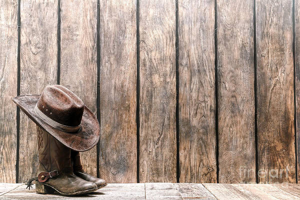 Cowboy Hat Photograph - Cowboy Hat On Boots by Olivier Le Queinec