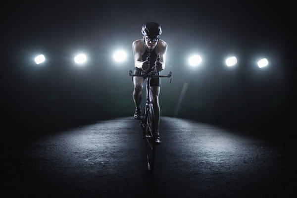 Helmet Photograph - Cyclist Riding At Night In The City by Stanislaw Pytel