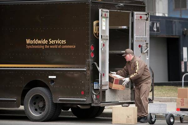 United States Postal Service Photograph - Deliver Driver Loading His Van by Jim West