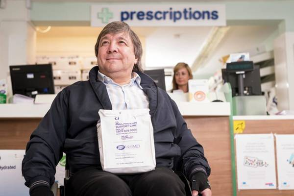 Patient Photograph - Disabled Man In Pharmacy by Jim Varney