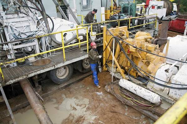 Drilling Rig Photograph - Dismantling A Natural Gas Drilling Rig by Jim West
