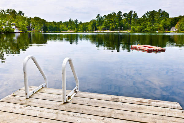 Photograph - Dock On Calm Lake In Cottage Country by Elena Elisseeva