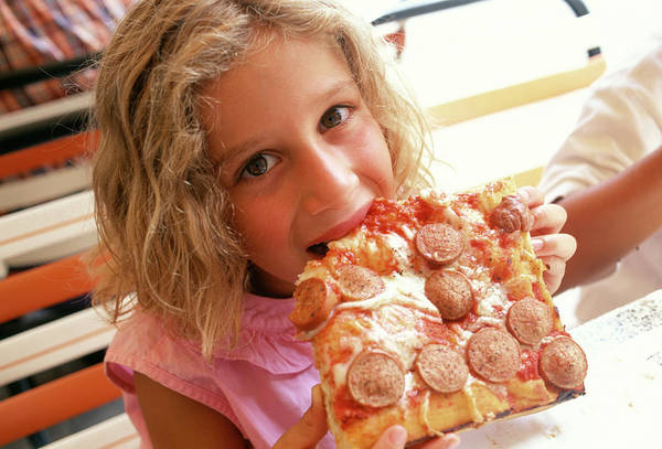 Pizza Photograph - Eating A Pizza by Mauro Fermariello/science Photo Library