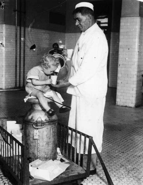 Photograph - Ellis Island Milkman, 1925 by Granger