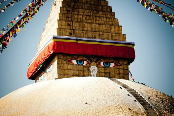 Wall Art - Photograph - Eye Of Tibetan Stupa Boudnath And Buddhist Prayer Flags  by Raimond Klavins