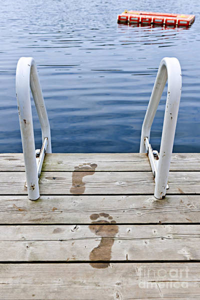 Photograph - Footprints On Dock At Summer Lake by Elena Elisseeva