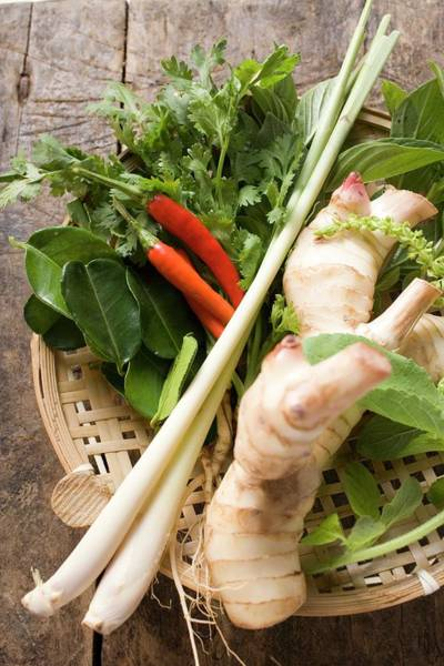 Wall Art - Photograph - Fresh Thai Herbs And Spices In Basket by Foodcollection