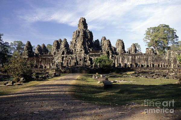Wall Art - Photograph - Gigantic Face Statues At Khmer Temple Angkor Wat Ruins Cambodi by Ryan Fox