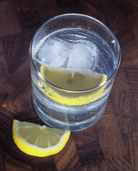 Tonic Photograph - Glass Of Gin And Tonic by Adam Hart-davis/science Photo Library