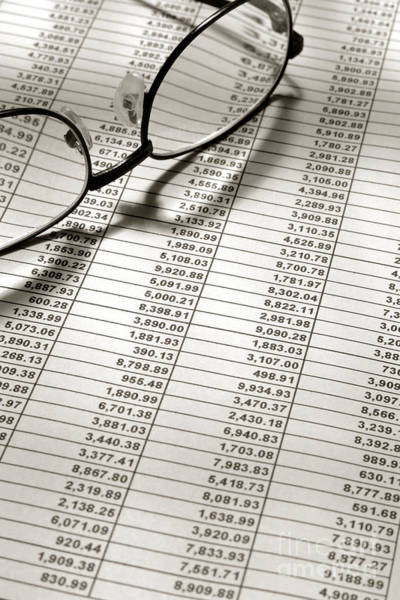 Wall Art - Photograph - Glasses On Financial Spreadsheet by Olivier Le Queinec