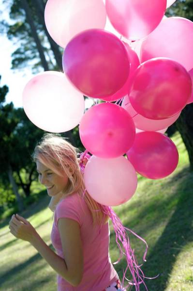 Breast Cancer Awareness Wall Art - Photograph - Happy Woman Holding Balloons by Ian Hooton/science Photo Library
