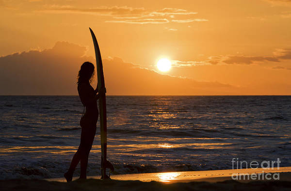 Wall Art - Photograph - Hawaii, Female Surfer On Beach Silhouetted Against Orange Sunset Over Ocean. by M Swiet Productions