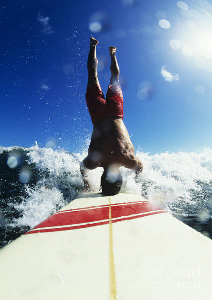 Wall Art - Photograph - Hawaii, Maui, Hookipa, Buzzy Kerbox Riding A Wave While Doing A Headstand. by Erik Aeder
