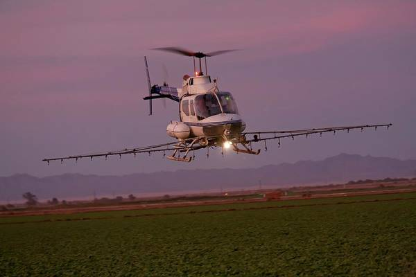 Copter Photograph - Helicopter Spraying Pesticides by Jim West