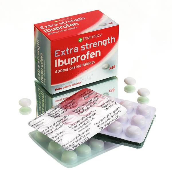 Wall Art - Photograph - Ibuprofen Tablets by Mark Sykes/science Photo Library