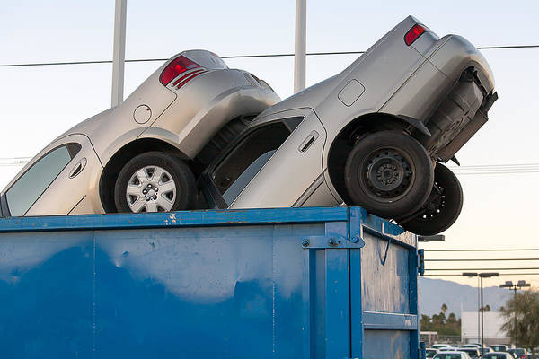 Clunker Wall Art - Photograph - Junk Cars In Dumpster Cash For Clunkers by Gunter Nezhoda
