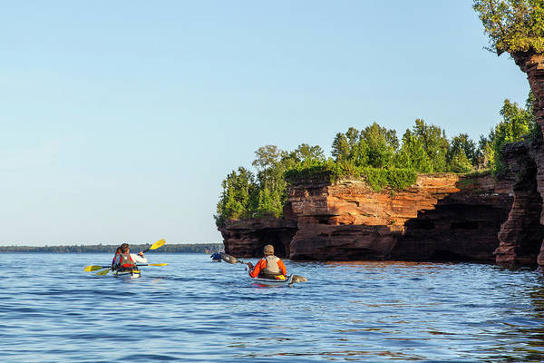 Kayaks Wall Art - Photograph - Kayakers Exploring The Sea Caves by Chuck Haney