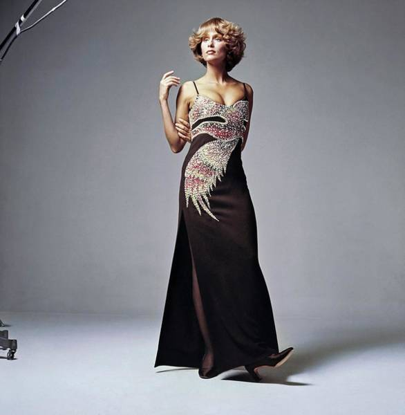 Wall Art - Photograph - Lauren Hutton Wearing A Galanos Dress by Bert Stern