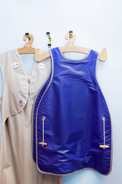 Protective Clothing Photograph - Lead Aprons by Gustoimages/science Photo Library