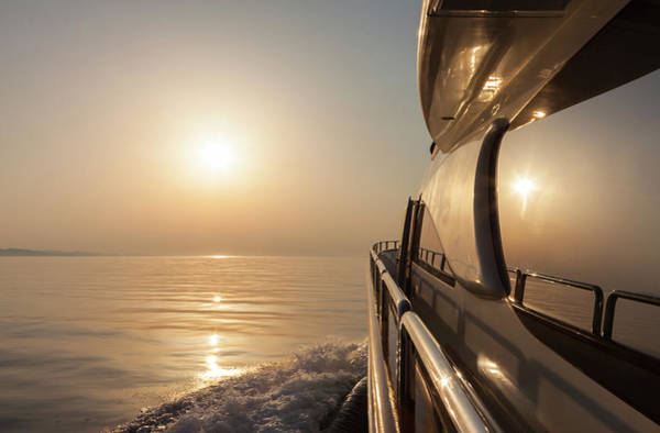 Yacht Photograph - Luxury Motor Yacht Sailing At Sunset by Petreplesea