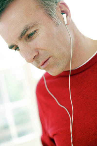 Wall Art - Photograph - Man Listening To Music by Ian Hooton/science Photo Library
