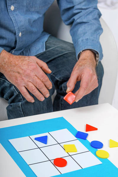 Wall Art - Photograph - Man Playing Game by Lea Paterson/science Photo Library