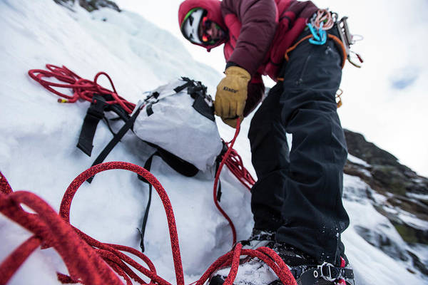 Wall Art - Photograph - Man Preparing Ropes Before Climbing by Joe Klementovich
