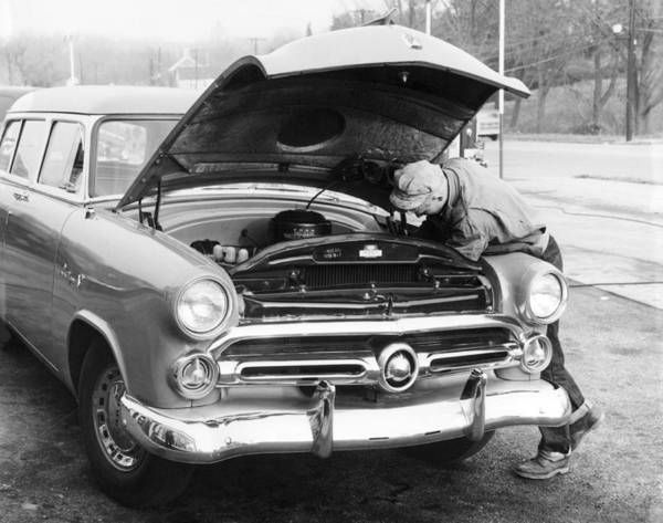 Thoroughfare Photograph - Man Working On His Car by Underwood Archives
