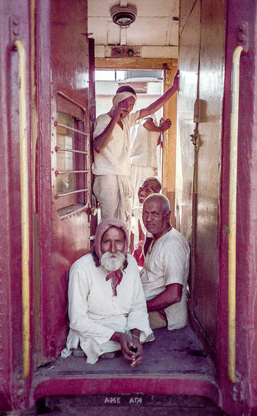 Photograph - Men On Train In India by Pete Hendley