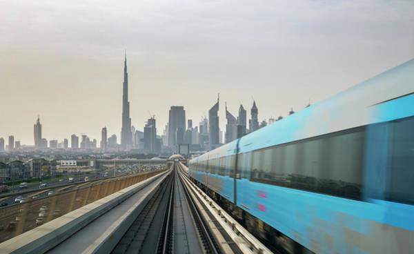 Rush Hour Photograph - Metro Train Reaching A Futuristic City by Buena Vista Images