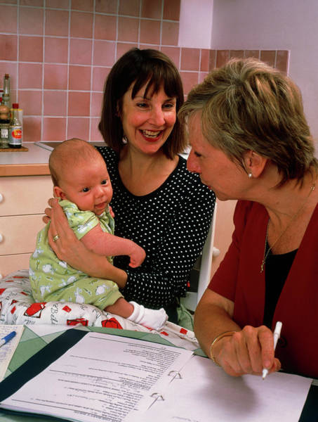 Wall Art - Photograph - Midwife With Mother & Baby In Post-natal Check-up by Hattie Young/science Photo Library