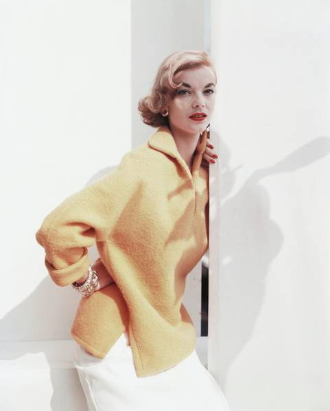 Yellow Background Photograph - Model Wearing Yellow Sweater by Horst P. Horst