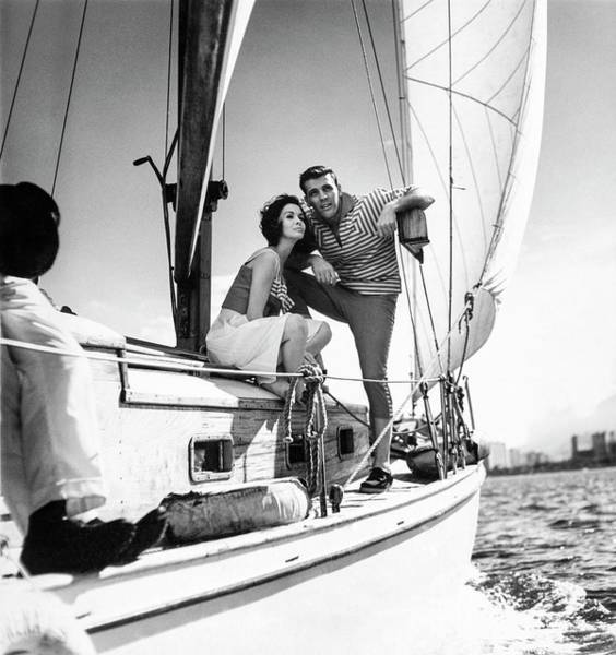 Sailing Photograph - Models On A Sailboat by Richard Waite