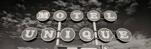 Sunny Side Up Wall Art - Photograph - Motel Unique Sign Seligman Az by Panoramic Images