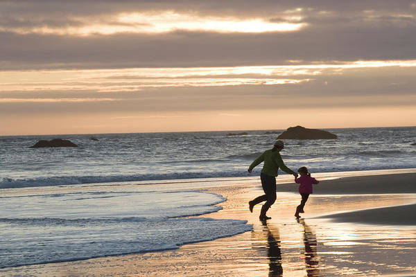 All Together Photograph - Mother And Daughter Walk Along Beach by Henry Georgi