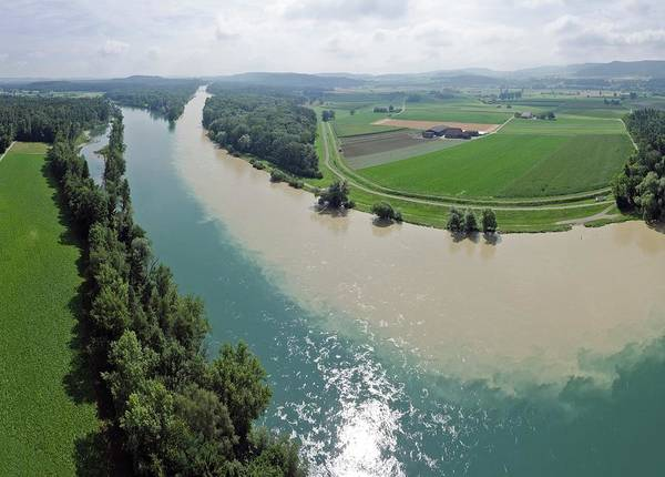 Rhine River Photograph - Muddy And Clear Rivers Merging by Dr Juerg Alean