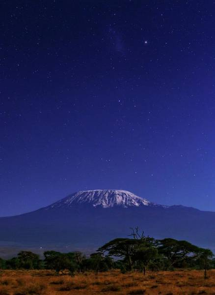 Mount Kenya Photograph - Night Sky Over Mount Kilimanjaro by Babak Tafreshi