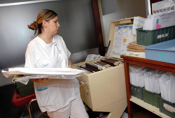 Wall Art - Photograph - Nurse And Hospital Records by Aj Photo/science Photo Library