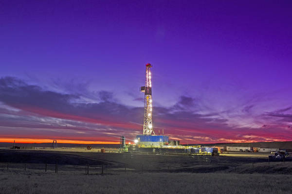 Oil Fracturing Drilling Rig At Dusk Art Print by Rich LaSalle